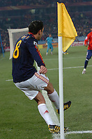 Xavi sends a corner kick into play. Spain won Group H following a 2-1 defeat of Chile in Pretoria's Loftus Versfeld Stadium, Friday, June 25th, at the 2010 FIFA World Cup in South Africa..