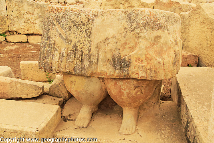 Tarxien neolithic megalithic prehistoric temple complex site, Malta - statue of skirt and legs of fat human figure