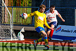 Anthony Shanahan, CSKA Tralee clears his defence as Killorglins Ryan keane attempts his clearance during their encounter in Mounthawk Park, Tralee on Sunday last.
