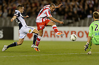 MELBOURNE, AUSTRALIA - MAY 19: Rafik Djebbour of Olympiakos kicks for goal during the match between Melbourne Victory and Olympiakos FC at Etihad Stadium on 19 May 2012 in Melbourne, Australia. (Photo Sydney Low / AsteriskImages.com)