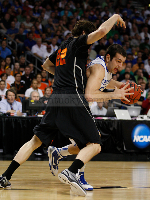 Josh Harrellson is guarded by Patrick Saunders in the first game of the 2011 NCAA Men's Basketball Tournament, against Princeton, at the St. Petersburg Times Forum, in Tampa, Fl.  Photo by Latara Appleby | Staff