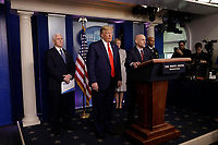 United States President Donald J. Trump, center, and US Vice President Mike Pence, left, listen to Stephen Hahn, Commissioner, US Food and Drug Administration (FDA), center right, speaking during a press briefing on the Coronavirus COVID-19 pandemic with members of the Coronavirus Task Force at the White House in Washington on March 19, 2020. From left to right: VP Pence; President President Donald J. Trump; Dr. Deborah L. Birx, White House Coronavirus Response Coordinator, Commissioner Hahn; and US Surgeon General Vice Admiral (VADM) Jerome M. Adams, M.D., M.P.H.<br /> Credit: Yuri Gripas / Pool via CNP/AdMedia