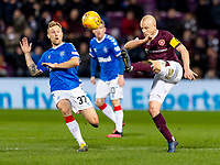 26th January 2020, Tynecastle Park, Edinburgh, Scotland; Scottish Premier League football, Hearts of Midlothian versus Rangers; Steven Naismith of Hearts clears the ball from Scott Arfield of Rangers