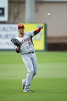 Hickory Crawdads first baseman Ronald Guzman (20) warms up in the outfield prior to the game against the Kannapolis Intimidators at CMC-Northeast Stadium on April 17, 2015 in Kannapolis, North Carolina.  The Crawdads defeated the Intimidators 9-5 in game one of a double-header.  (Brian Westerholt/Four Seam Images)