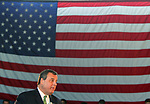 Gov. Chris Christie holds a town hall meeting at the National Guard armory in Freehold on Tuesday March 17,2015.<br />  Christie walks past the American flag as he speaks during his town hall meeting.
