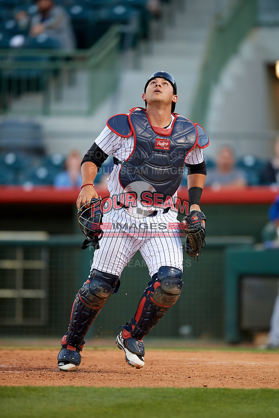 Florida Fire Frogs catcher Alex Jackson (25) tracks a pop up during a game against the Dunedin Blue Jays on April 10, 2017 at Osceola County Stadium in Kissimmee, Florida.  Florida defeated Dunedin 4-0.  (Mike Janes/Four Seam Images)