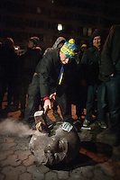 The head of The Lenin statue is being shattered by the outraged protesters in Kiev
