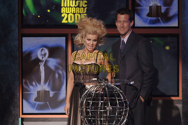 CARMEN ELECTRA & JAMES DENTON.At The World Music Awards-Show held at the Kodak Theatre,.Hollywood, 31st  August 2005.half length stage microphone black sheer chiffon dress big hair.www.capitalpictures.com.sales@capitalpictures.com.© Capital Pictures.