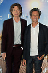 Bristish musician and co-producer Mick Jagger (L) and US producer Brian Grazer pose during a photocall to present 'Get on up' during the 40th Deauville US Film Festival, on September 12, 2014