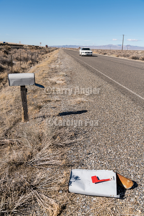 Trashed mailbox along the frontage road next to I-80, Imlay, Nev.