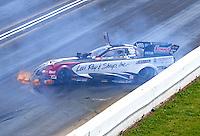 May 22, 2016; Topeka, KS, USA; NHRA funny car driver Tim Wilkerson crashes during the Kansas Nationals at Heartland Park Topeka. Wilkerson was uninjured in the accident. Mandatory Credit: Mark J. Rebilas-USA TODAY Sports