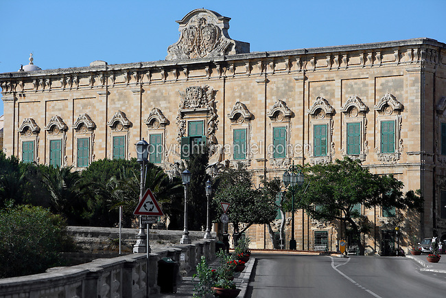 Low angle view of the Auberge de Castille (Il-Berga ta' Kastilja), 1571, Valletta, Malta, pictured on June 7, 2008, in the morning.  The Republic of Malta consists of seven islands in the Mediterranean Sea of which Malta, Gozo and Comino have been inhabited since c.5,200 BC. Nine of Malta's important historical monuments are UNESCO World Heritage Sites, including  the capital city, Valletta, also known as the Fortress City. Built in the late 16th century and mainly Baroque in style it is named after its founder Jean Parisot de Valette (c.1494-1568), Grand Master of the Order of St John. The Knights of St John built an auberge, or inn, for each nationality of knight who passed through Malta. This one, for Castilians, was designed by Girolamo Cassar, and re-modelled in 1741, probably by Andrea Belli. It is now the Prime Minister's office. Picture by Manuel Cohen.