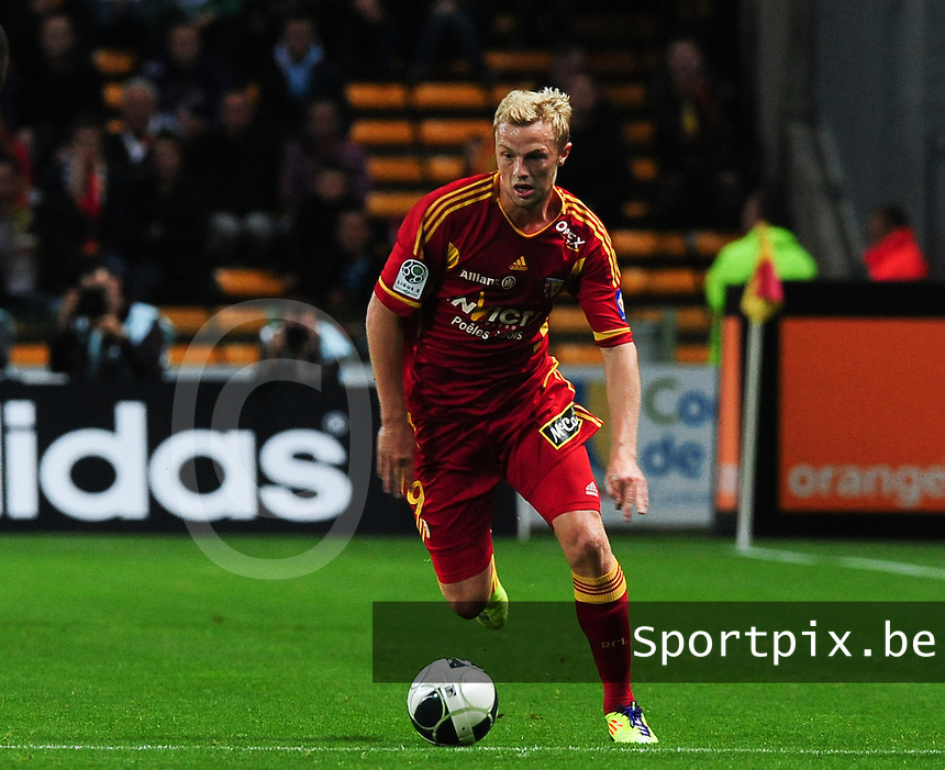 20110916 - LENS , FRANCE : RC Lens'  DAVID POLLET pictured during the soccer match between Racing Club de LENS and BOULOGNE , on the seventh matchday in the French Ligue 2 at the Stade Bollaert Delelis stadium , Lens . Friday 16 September 2011 . PHOTO DAVID CATRY