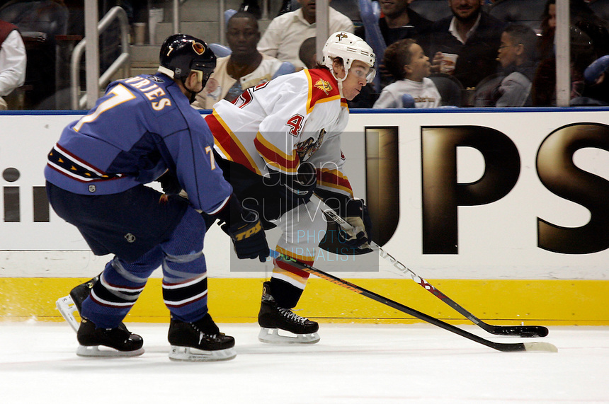 Florida Panthers left wing David Booth (46) and Atlanta Thrashers defenseman Greg de Vries (7) battle for the puck in the second period at Philips Arena. The Thrashers won the game 1-0.<br />