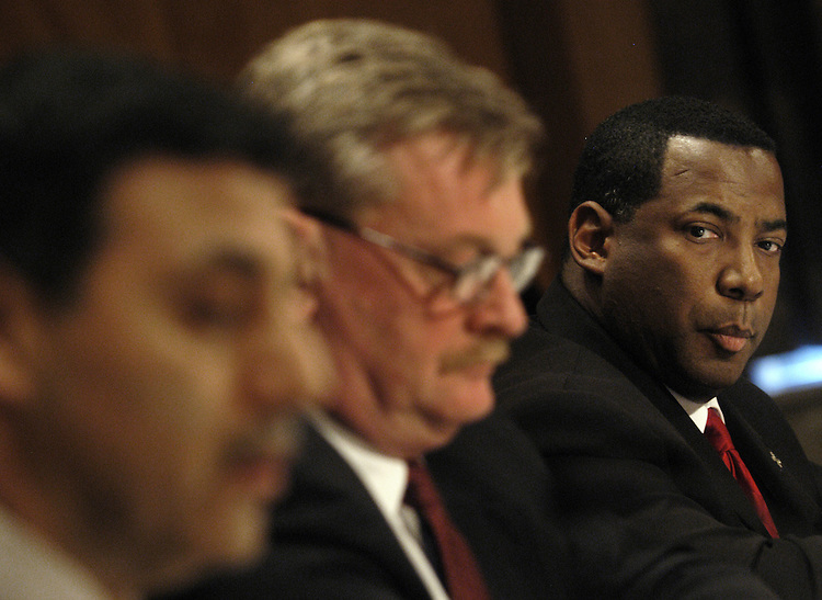 "Warren Riley (R), superintendent of police, New Orleans Police Department, watches Michael Vanacore, director of international affairs, U.S. Immigration and Customs Enforcement, Homeland Security Department; and Kenneth Kaiser, special agent in charge, Boston Field Office, FBI,  testify at a Senate Homeland Security and Governmental Affairs Committee hearing on ""Hurricane Katrina: Managing Law Enforcement and Communications in a Catastrophe.""."