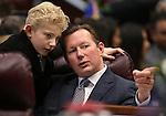 Nevada Sen. Ben Kieckhefer, R-Reno, talks with his son Austin, 8, during opening day ceremonies at the Legislative Building in Carson City, Nev., on Monday, Feb. 2, 2015. (Cathleen Allison/Las Vegas Review-Journal)