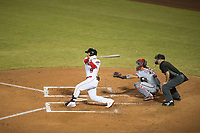 Mesa Solar Sox second baseman Jahmai Jones (9), of the Los Angeles Angels organization, follows through on his swing in front of catcher Tres Barrera (12) and home plate umpire Dan Merzel during an Arizona Fall League game against the Salt River Rafters at Sloan Park on October 16, 2018 in Mesa, Arizona. Salt River defeated Mesa 2-1. (Zachary Lucy/Four Seam Images)