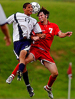 Fauquier's Scott Rossi (7) battles Harrisonburg's Jose Ibarra (17) for a header during Fauquier's 2-1 season ending loss to Harrisonburg in regional state playoffs May 31, 2004 at Harrison Middle School in Harrisonburg, VA.