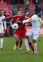 20 April 2013: Toronto FC defender Jeremy Hall #25 and Houston Dynamo midfielder Luiz Camargo #17in action during the second half in an MLS game between the Houston Dynamo and Toronto FC at BMO Field in Toronto, Ontario Canada..The game ended in a 1-1 draw...