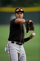 Left fielder Edison Lantigua (25) of the Delmarva Shorebirds warms up before a game against the Greenville Drive on Friday, August 2, 2019, at Fluor Field at the West End in Greenville, South Carolina. The game was suspended in the second inning and will not be made up. (Tom Priddy/Four Seam Images)