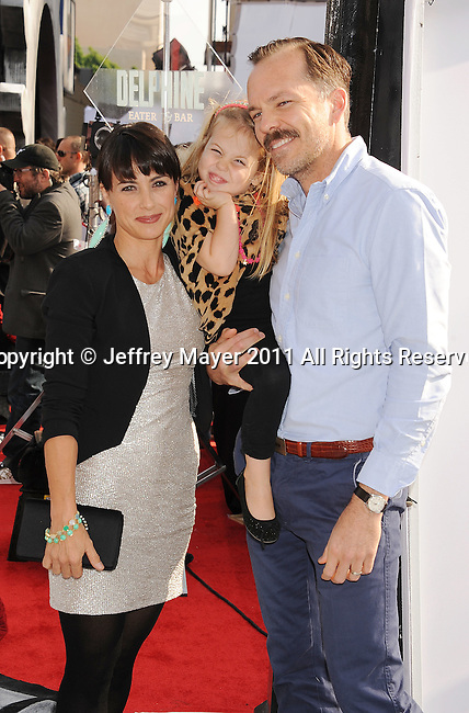 "HOLLYWOOD, CA - SEPTEMBER 25: Constance Zimmer, Russ Lamoureux and Colette attend Premiere Of ""Iris"" - A Journey Into The World Of Cinema By Cirque du Soleil at the Kodak Theatre on September 25, 2011 in Hollywood, California."