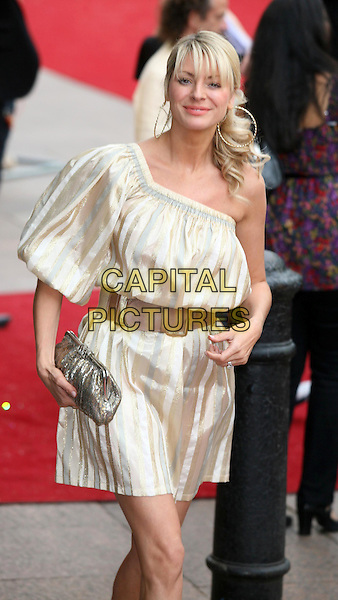"TESS DALY.Arrivals at the ""Sex And The City: The Movie"" World Premiere, Odeon Leicester Square, London, England, UK. .May 12th 2008 .SATC half length gold silver striped dress one shoulder belt waist hoop earrings clutch bag.CAP/DS.©Dudley Smith/Capital Pictures"