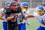 Palos Verdes, CA 09/20/13 - Tyler Moore (Palos Verdes #3) and Danny Ngo (El Toro #4) in action during the El Toro versus Palos Verdes varsity football game at Palos Verdes High School.