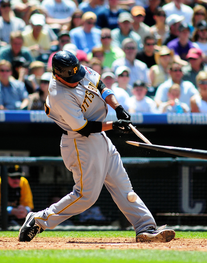 June 21, 2009: Pirates outfielder Delwyn Young breaks his bat and hits the ball into his shin during a game between the Pittsburgh Pirates and the Colorado Rockies at Coors Field in Denver, Colorado. The Rockies beat the Pirates 5-4, to improve to 16-1 in the last 17 games.
