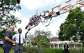 United States President Barack Obama (L) examines a robotic giraffe with Lindsay Lawlor of San Diego, California, at the White House Maker Faire projects on the South Lawn, June 18, 2014, in Washington, DC. The Faire is a series of projects by students,  entrepreneurs and regular citizens using new technologies and tools to launch new businesses and learning new skills in science, technology, engineering and mathematics.  <br /> Credit: Mike Theiler / Pool via CNP