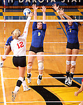 BROOKINGS, SD - OCTOBER 5:  Lexi Fowler #9 and Tiara Gibson #7 from South Dakota State University team up for a block on Kendall Krittenbrink #12 from the University of South Dakota in the second game of their match Saturday night at Frost Arena. (Photo by Dave Eggen/Inertia)