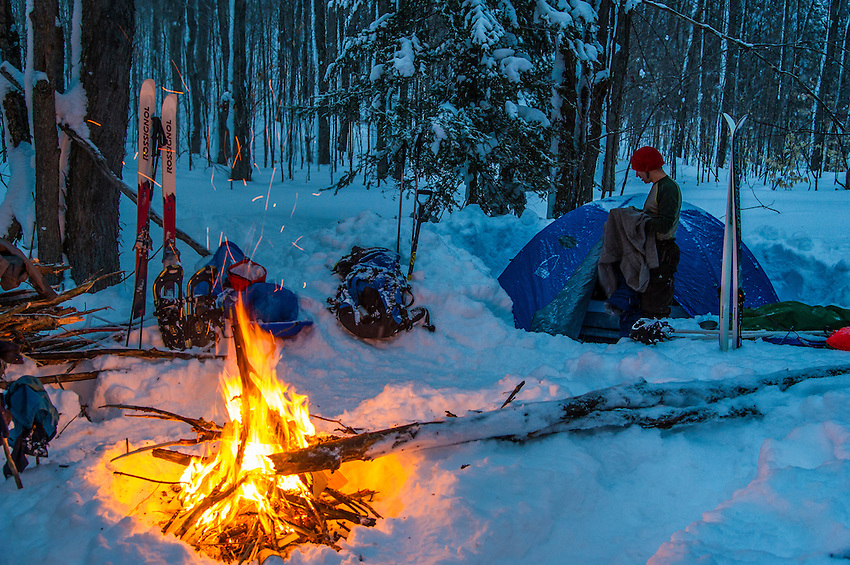 Building a fire and making camp while winter camping on Michigan's Upper Peninsula.