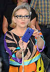 Carrie Fisher arriving at the Los Angeles premiere of Vacation held at Regency Village Theatre Westwood CA. July 27, 2015.