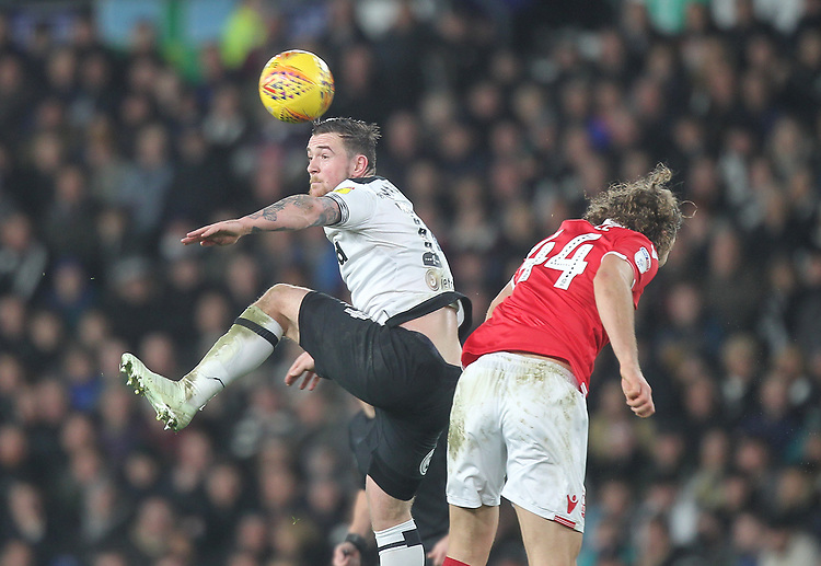 Derby County's Jack Marriott jumps with Nottingham Forest's Michael Hefele<br /> <br /> Photographer Mick Walker/CameraSport<br /> <br /> The EFL Sky Bet Championship - Derby County v Nottingham Forest - Monday 17th December 2018 - Pride Park - Derby<br /> <br /> World Copyright © 2018 CameraSport. All rights reserved. 43 Linden Ave. Countesthorpe. Leicester. England. LE8 5PG - Tel: +44 (0) 116 277 4147 - admin@camerasport.com - www.camerasport.com