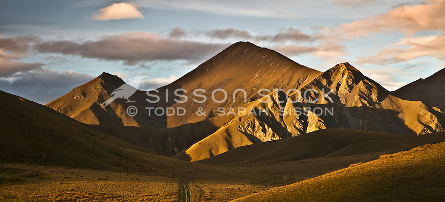 Sunlit hills in the Lindis Pass, Summer, Central Otago, South Island, New Zealand - stock photo, canvas, fine art print