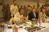 United States Secretary of Defense Donald H. Rumsfeld (2nd from right) has dinner with the Commander of the Republic of Korea Division Major General Hwang Ui-don in Irbil, Iraq, on October 10, 2004.  Rumsfeld is in Iraq to show support for the coalition troops and meet with Iraqi officials. <br /> Mandatory Credit: James M. Bowman / DoD via CNP