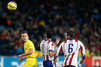 Koke and Raul Garcia of Atletico de Madrid and Cheryshev of Villarreal during La Liga match between Atletico de Madrid and Villarreal at Vicente Calderon stadium in Madrid, Spain. December 14, 2014. (ALTERPHOTOS/Caro Marin) /NortePhoto