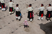 East Village, Diqing Tibetan Autonomous Prefecture, Yunnan Province, China - A Tibetan toddler dances to the tune of traditional Xianzi Dance, February 2017.