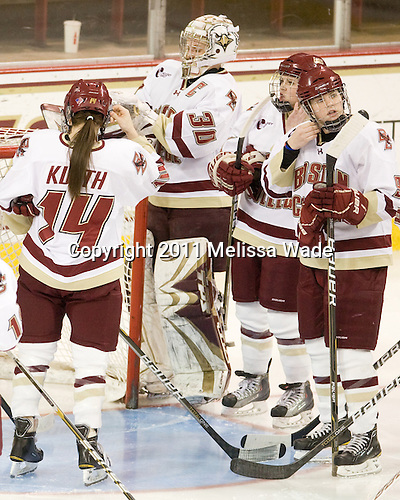 Katelyn Kurth (BC - 14), Molly Schaus (BC - 30), Taylor Wasylk (BC - 9) - The Boston College Eagles defeated the Boston University Terriers 2-1 in the opening round of the Beanpot on Tuesday, February 8, 2011, at Conte Forum in Chestnut Hill, Massachusetts.
