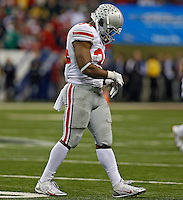 Ohio State Buckeyes running back Carlos Hyde (34) walks to the sideline after Ohio State Buckeyes didn't make a first down on their last offensive play in the 4th quarter against the Michigan State Spartans defense during the Big 10 Championship game at Lucas Oil Stadium in Indianapolis, Ind on December 7, 2013.  (Dispatch photo by Kyle Robertson)