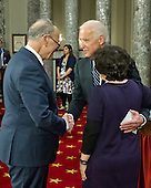 United States Vice President Joe Biden, center, greets US Senator Chuck Schumer (Democrat of New York), left, prior to administering the oath of office during a mock swearing-in ceremony in the Old US Senate Chamber in the US Capitol in Washington, DC on Tuesday, January 3, 2017.  Schumer's wife, Iris Weinshall, is a right with her back to the camera. <br /> Credit: Ron Sachs / CNP<br /> (RESTRICTION: NO New York or New Jersey Newspapers or newspapers within a 75 mile radius of New York City)