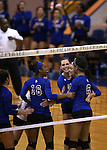 The Marymount Saints celebrate a point in a college volleyball game against St. Mary's, in Lexington Park, MD, on Wednesday, Oct. 29, 2014. Marymount won 3-2 to go 24-9 on the season.<br /> Photo by Cathleen Allison