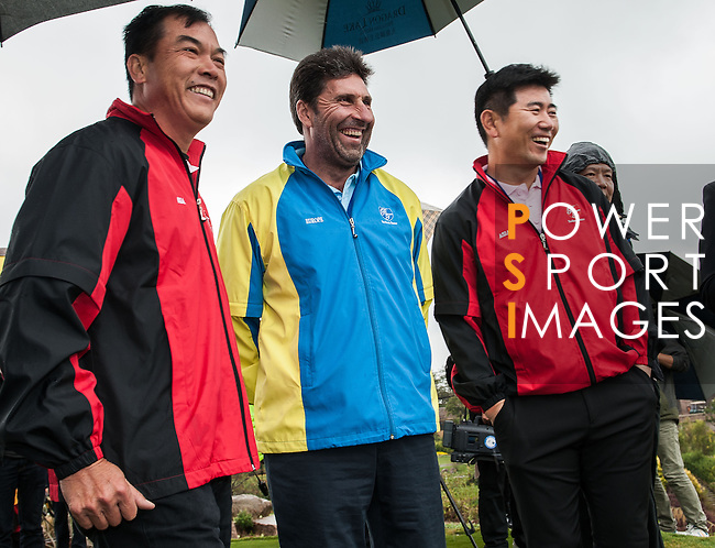 Players pose for official photo during the Royal Trophy  Europe vs Asia Golf Championship at the Dragon Lake Golf Club in Guangzhou, China on 17 December 2013. Photo by Xaume Olleros / The Power of Sport Images