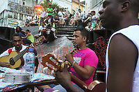 "Roda de samba, meeting of musicians around a table for playing samba at Pedra do Sal in the port zone of the city. Pedra do Sal ( ""Rock of Salt"" ), a historical and religious site in Rio de Janeiro, in the neighborhood of Saude, was originally a quilombo village. It is a place with special significance for Cariocas of African descent and fans of samba and choro music. It is considered the center of the area known locally as ""Little Africa"", which was full of collective houses of escaped and freed slaves."