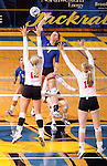 BROOKINGS, SD - OCTOBER 5:  Tiara Gibson #7 from South Dakota State University tries to get a kill past Kendall Krittenbrink #12 from the University of South Dakota in the second game of their match Saturday night at Frost Arena. (Photo by Dave Eggen/Inertia)