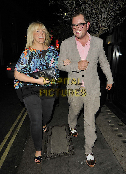 Sally Lindsay & Alan Carr .spotted walking along West Street, Covent Garden, London, England..July 9th, 2012.full length beige suit pink shirt glasses blue green tropical floral print shirt black trousers walking .CAP/CAN.©Can Nguyen/Capital Pictures.