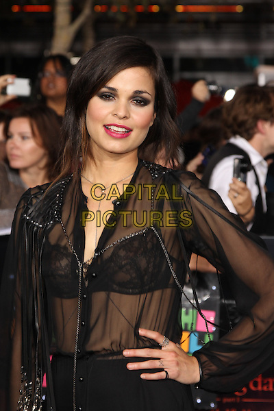 LINA ESCO.The Los Angeles premiere of 'The Twilight Saga Breaking Dawn Part 1' at Nokia Theatre at L.A. Live in Los Angeles, California, USA..November 14th, 2011.half length black sheer blouse top see through thru bra hand on hip red lipstick .CAP/CEL .©CelPh/Capital Pictures