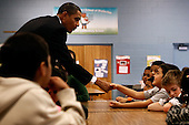 Silver Spring, MD - October 19, 2009 -- United States President Barack Obama speaks to third and fourth graders during their lunch period at Viers Mill Elementary School, Tuesday, October 19, 2009 in Silver Spring, Maryland. The elementary school was named a 2005 National Title I No Child Left Behind Blue Ribbon school. .Credit: Chip Somodevilla / Pool via CNP