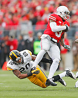 Ohio State Buckeyes quarterback Braxton Miller (5) spins away from Iowa Hawkeyes linebacker Christian Kirksey (20) in the second half at Ohio Stadium on October 19, 2013.  (Chris Russell/Dispatch Photo)