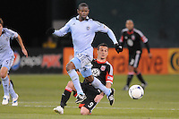 Sporting Kansas City defender Julio Cesar (55) goes against D.C. United forward Hamid Salihi (9) Sporting Kansas City defeated D.C. United  1-0 at RFK Stadium, Saturday March 10, 2012.