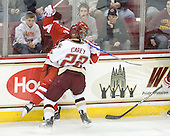 Paul Carey (BC - 22) received a roughing minor for this hit on Garrett Noonan (BU - 13) at the end of the first period. - The Boston College Eagles defeated the visiting Boston University Terriers 5-2 on Saturday, December 4, 2010, at Conte Forum in Chestnut Hill, Massachusetts.
